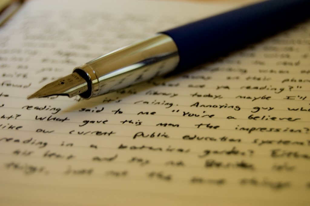 Image of a letter being written.
