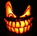 Jack-o-lantern grin showing the way light from behind can play off the emotions carried in its face.